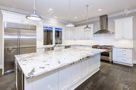 pictures of white kitchen cabinets with island large spacious kitchen design with white kitchen cabinets white