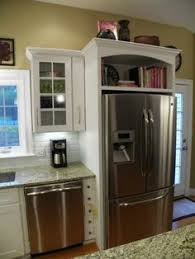 space between top of refrigerator and cabinet 32 kitchen cabinets around refrigerator for more storage space
