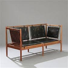 a solid mahogany sofa bench sides and back with vertical slats