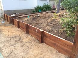 diy timber retaining wall in the making treated pine lengths with