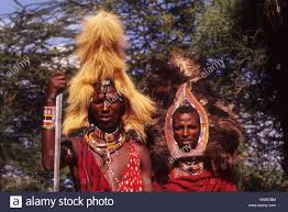 masai warrior with mane headress and other with ostrich
