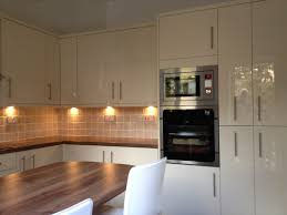white kitchen decoration using square cream stone tile kitchen