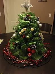mesh ribbon table decorations a deco mesh mini ribbon tree with christmas trees pinterest