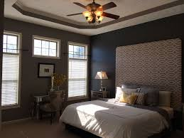 eclectic master bedroom with crown molding ceiling fan in eclectic master bedroom with hunter douglas parkland reflections horizontal blinds ceiling fan carpet