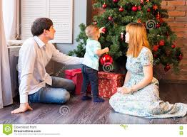 happy family decorating christmas tree together father mother