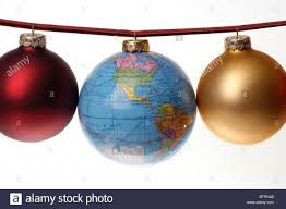 ornaments or baubles strung on a plaid ribbon with