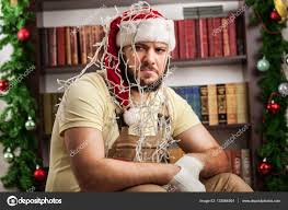 fixing christmas tree lights man trying to fix christmas tree lights stock photo