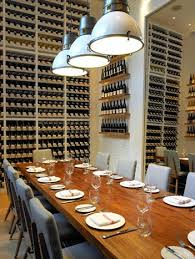 the private dining room has a floor to ceiling wine wall the