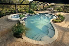 Backyard City Pools wonderful pool design which has twin fountains and floating