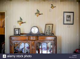 flying ducks on vintage wallpaper in a second world war living