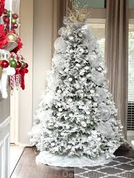 white tree with silver decorations happy holidays