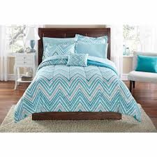 Blue Laminate Flooring Zigzag Striped Blue Toddler Bedding Sets On Brown Wooden Bed With