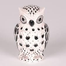 get some black white flair in your home decor my kirklands blog black lantern white bowl black and white owl