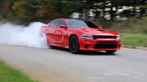 charger hellcat burnout incredible dodge hellcat performs insane loud smoke filled burnout