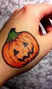 jack o lantern halloween tattoo on hand tattoo pinterest