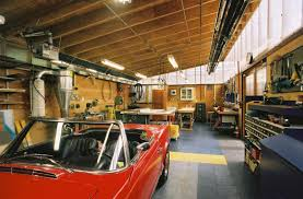 a man u0027s paradise spacious garage design with room for workshop