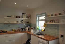 dark grey subway tile backsplash and white farmhouse kitchen sink