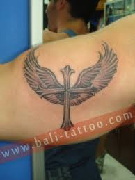 tattoo back cross tattoo of cross with angel wings on back photos pictures and