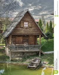 Small Cottage by Small Wooden Cottage With A Boat Stock Photo Image 47241398