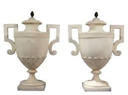 marble urns a pair of white marble urns with a pine bronze decoration george