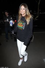 gucci black friday heidi klum cuts a casual figure in white trousers daily mail online