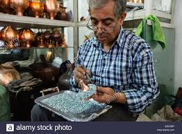 artist sets stones for minakari unique art esfahan which