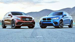 bmw vs mercedes 2015 bmw x6 m vs 2016 mercedes amg gle63 s coupe 2 ep