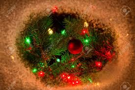 christmas branches with lights red christmas ornament and lights hanging from real fir tree stock