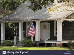american flag on porch of house thomasville georgia usa stock