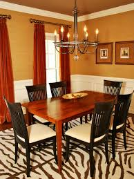 classic smooth red wall color with natural wooden poker dining