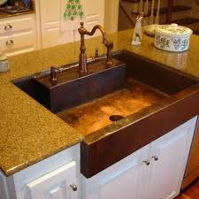 awesome copper vent hood over stove with copper farmhouse sink and