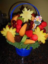 incredibles edibles arrangements swizzle chocolate strawberries surrounded by pineapple flowers and