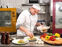 kitchen chef chef preparing food in the kitchen at the restaurant stock photo