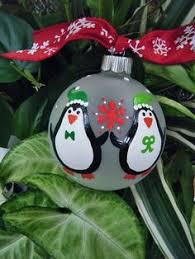 painted penguin ornament 10 00 via etsy