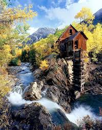 Colorado travel log images Dilapidated log cabin atop a cliff in the mountains by a river png