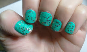 liquored and lacquered mint green nails with glitter