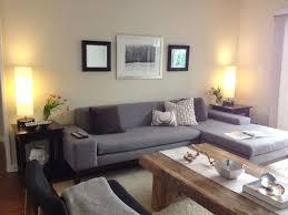 living room grey fabric sectional sofa cream cushions wood