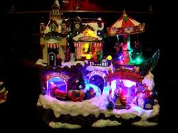 Animated Christmas Village Decorations by Illuminated Animated Christmas Village With Train And Carousel