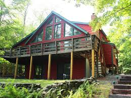 chalet house big bass lake house rental front view of the house jpg