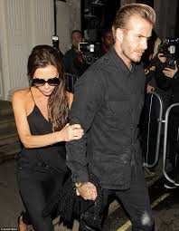 victoria beckham clings on to david leaving her boutique after