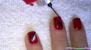 elegant red nail art with black u0026 white feathers diy pretty nails