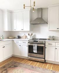 white kitchen cabinets black knobs pin on kitchen cabinets