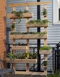 outdoor wall decor ideas with wood plants and lights pots