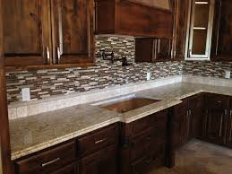 granite countertop redwood cabinets brown mosaic tile backsplash