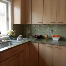 green kitchen backsplash green glass subway tile with maple cabinets kitchen green
