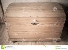 old wooden chest like treasure box in the attic stock photo