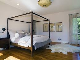 contemporary guest bedroom with hardwood floors u0026 flush light in