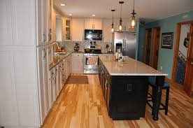 frankenmuth kitchen custom hardwood floors by jeffries after removing all the upper cabinets and soffits we moved the peninsula cabinets to the wall left of the dishwasher we then built all new upper cabinets