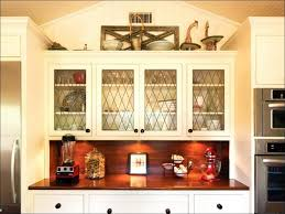 Above Kitchen Cabinets Ideas Kitchen Cabinet Toppers Over The Cabinet Storage Decorating