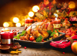thanksgiving dinner table served with turkey decorated with